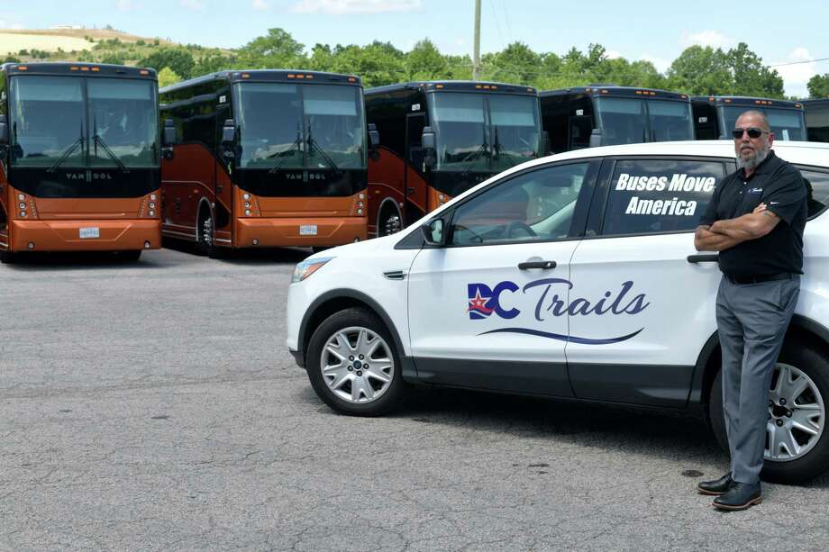 William Torres, president of DC Trails, on his lot Wednesday in Lorton, Va., where many of his 70 motor coaches have been parked. Photo: Washington Post Photo By Marvin Joseph / The Washington Post