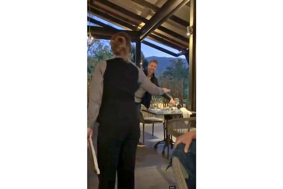 A screengrab from a video posted by @jordanlizchan to social media showing a Lucia Restaurant & Bar server, left, ordering a customer, right, to leave the restaurant after they made racist, anti-Asian comments to other patrons. Photo: @jordanlizchan