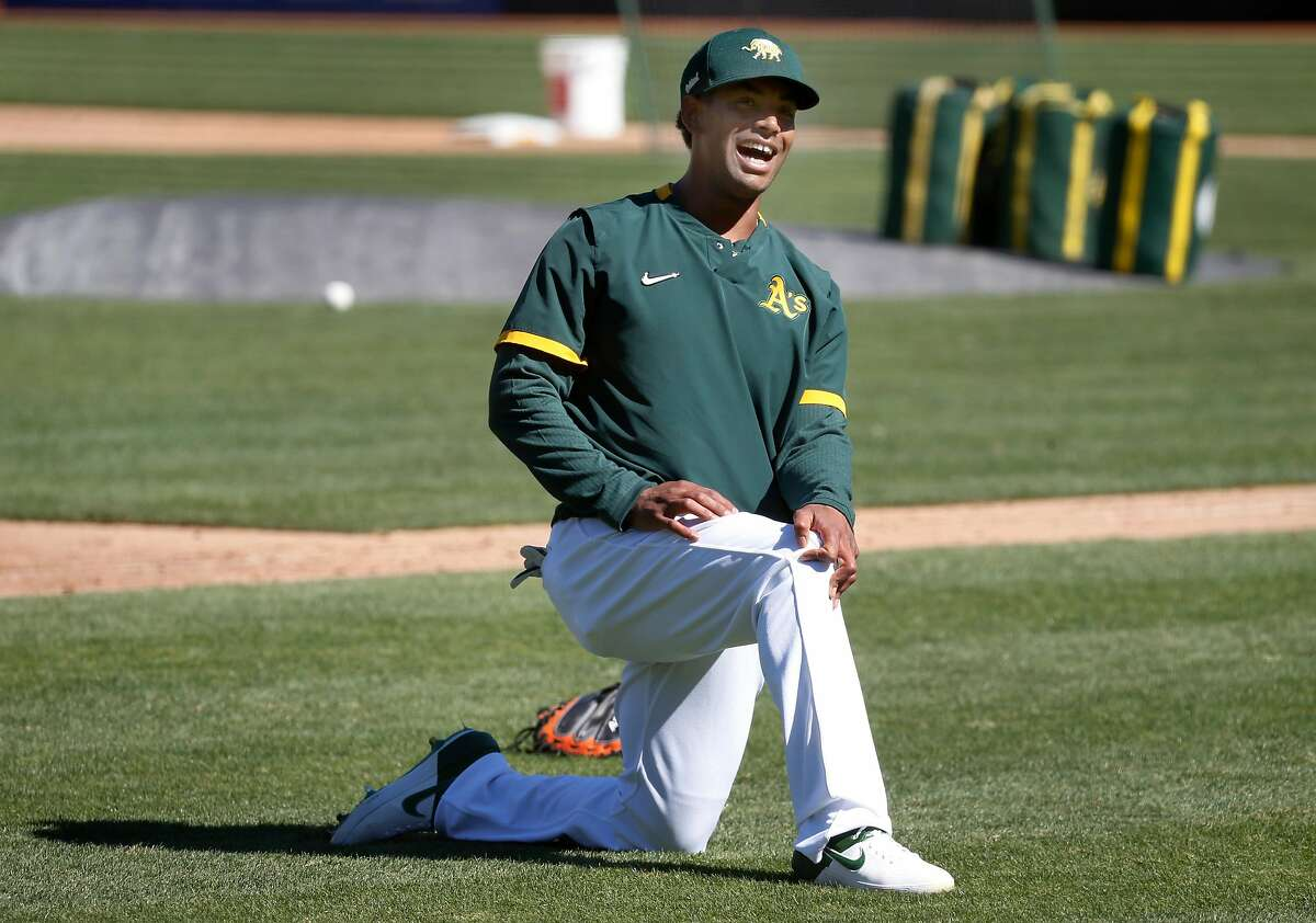 Khris Davis stretches during the Oakland A's summer training camp at the Coliseum in Oakland, Calif. on Saturday, July 11, 2020.