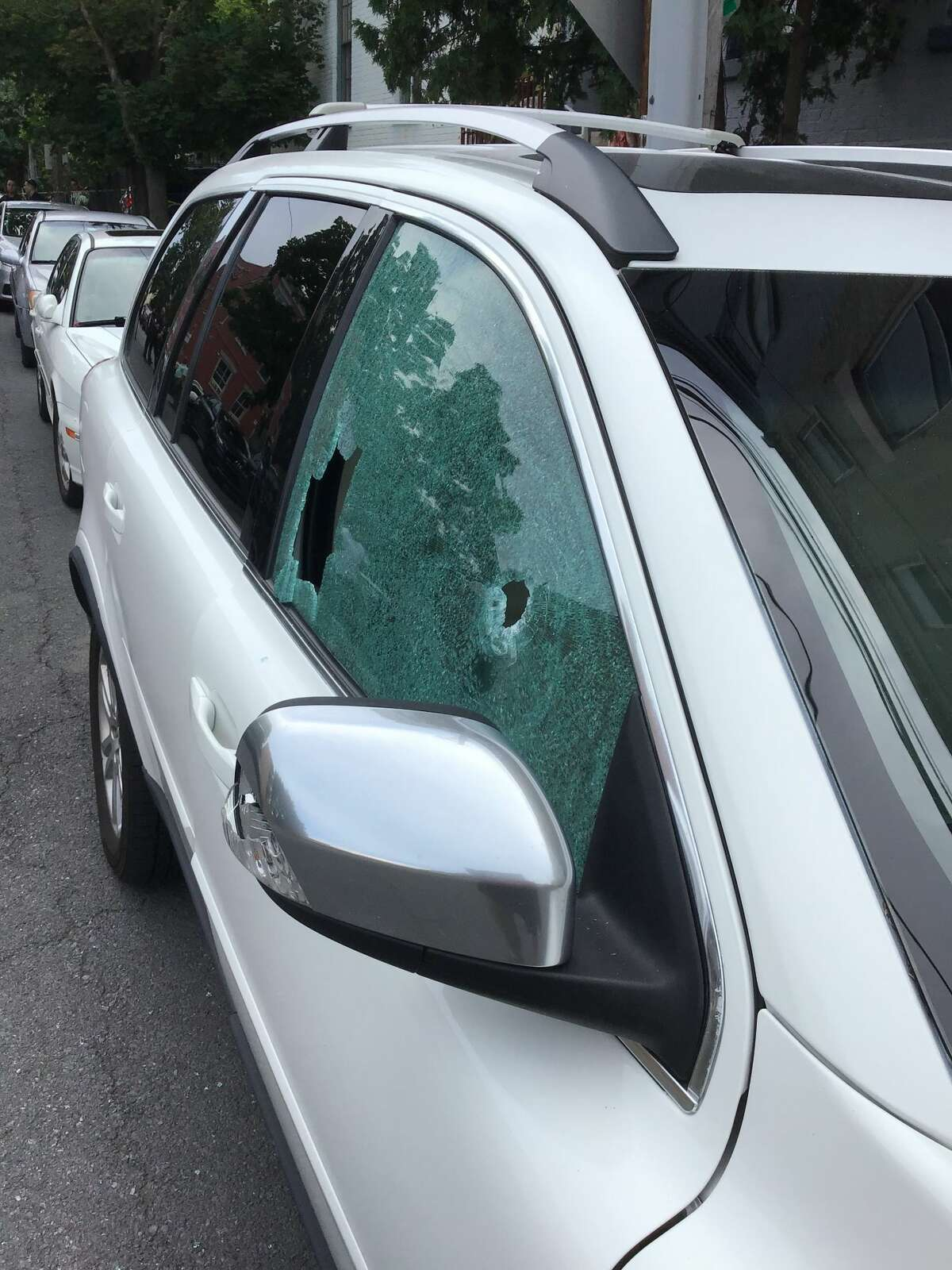 The window of a vehicle where shattered by gunshots Saturday, July 11, 2020 on Trinity Place in Albany. (Provided photo)