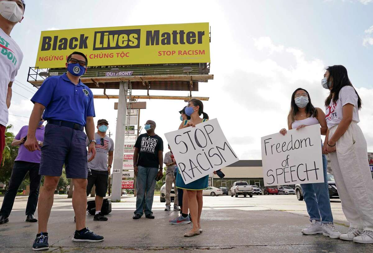 State Rep. Gene Wu, left, joins others Saturday in support of a Black Lives Matter billboard at 11107 Bellaire Blvd.