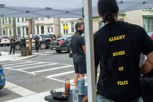 The community group Albany House of Peace had a rally scheduled for 1 p.m. at the intersection of Judson and Second streets on Saturday, July 11, 2020 in Albany NY. At 12:40 p.m., there was a shooting three doors down Second Street and police are seen processing the scene in the background (Jim Franco/special to the Times Union.)