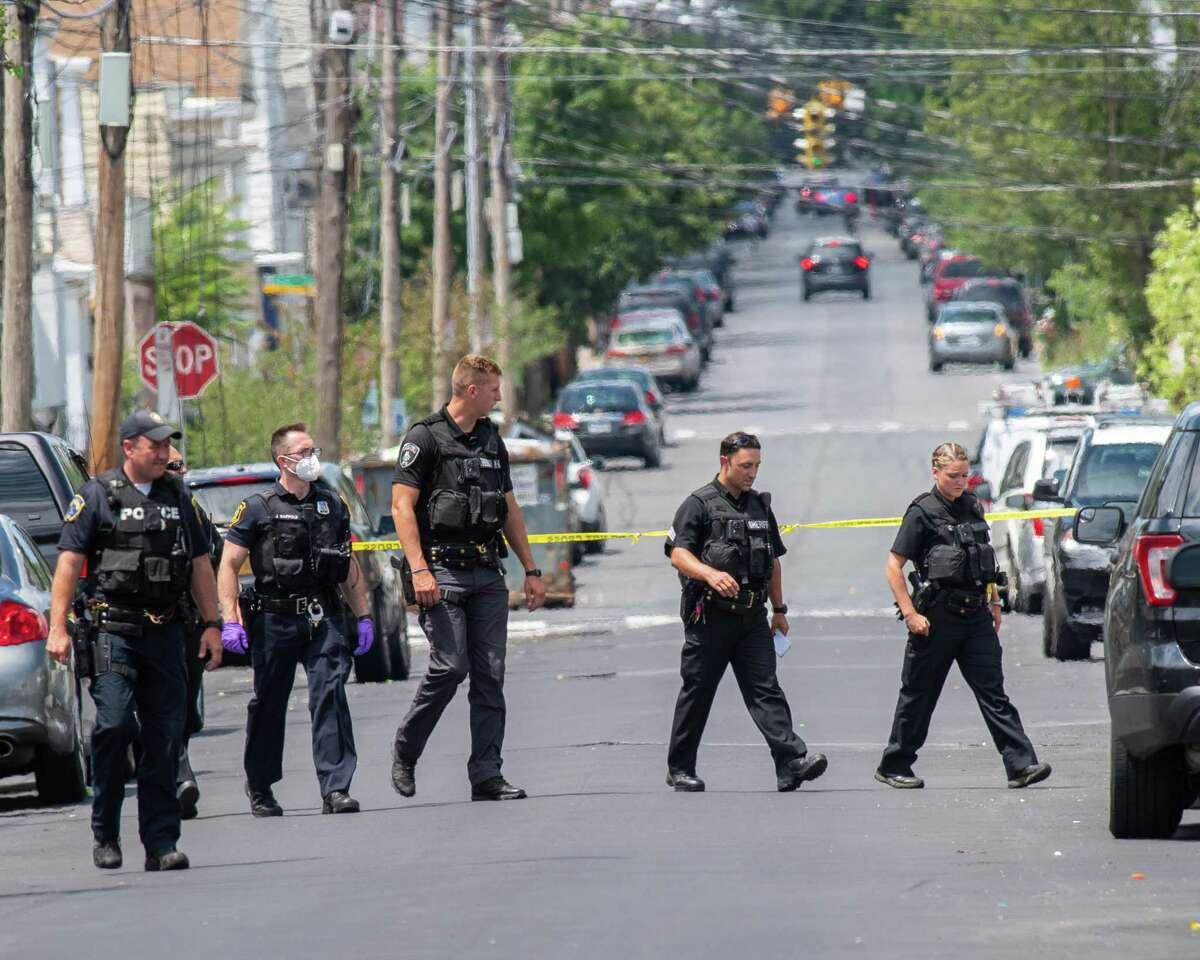 Albany police and Albany County Sheriff deputies canvass Second Street, the site of the citya€™s most recent shooting on Saturday, July 11, 2020. According to police, an 18-year-old male was shot in the leg and taken to Albany Medical Center Hospital for treatment of non-life threatening injuries. (Jim Franco/special to the Times Union.)