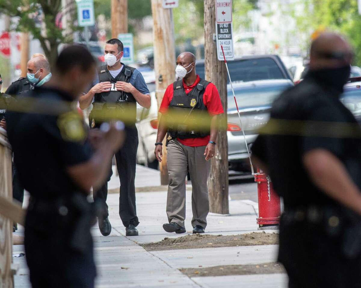 Albany police process a shooting scene on Saturday, July 11, 2020. On Aug. 8, 2020 the city experienced its 11th homicide, after four people were shot at First and Quail streets. (Jim Franco/special to the Times Union.)