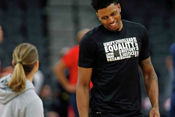 SAN ANTONIO, TX - FEBRUARY 2: Rudy Gay #22 of the San Antonio Spurs shares a light moment with assistant coach Becky Hammon before the start of their game against the New Orleans Pelicans at AT&T Center on February 2, 2019 in San Antonio, Texas. NOTE TO USER: User expressly acknowledges and agrees that , by downloading and or using this photograph, User is consenting to the terms and conditions of the Getty Images License Agreement. (Photo by Ronald Cortes/Getty Images)