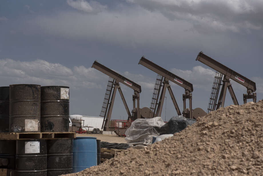 A line of pumping units at a Diamondback Energy drill site. Mercer Capital says the Permian has not been immune to the difficult economic environment the industry is seeing. But its economics should help it fare better than other producing regions. Photo: Callaghan O'Hare/Bloomberg / © 2019 Bloomberg Finance LP