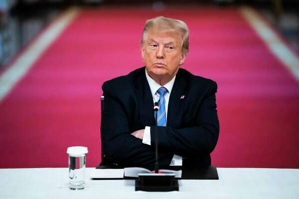 President Donald Trump crosses his arms as he participates in a roundtable discussion on the reopening of schools at the White House on July 7.