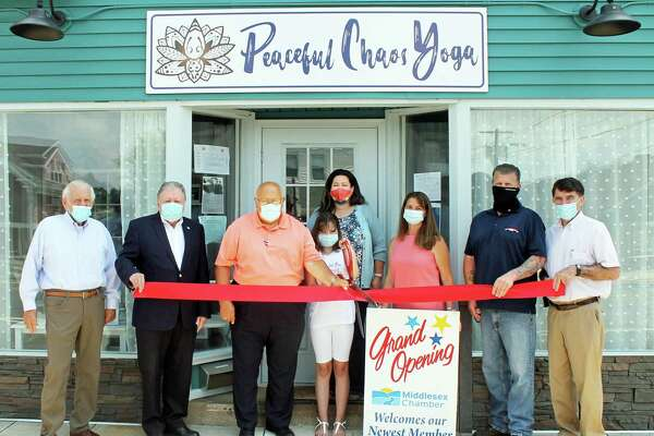 The Middlesex County Chamber of Commerce welcomed its newest member, Peaceful Chaos Yoga at a grand opening. Shown are President Larry McHugh, past chairman Jay Polke, Cromwell Town Manager Tony Salvatore, owner Jeannine Marron, Marron's daughter Chloe Nixdorf, state Rep. Christie Carpino, Cromwell Division Chairman Rodney Bitgood, and Town Planner Stuart Popper.