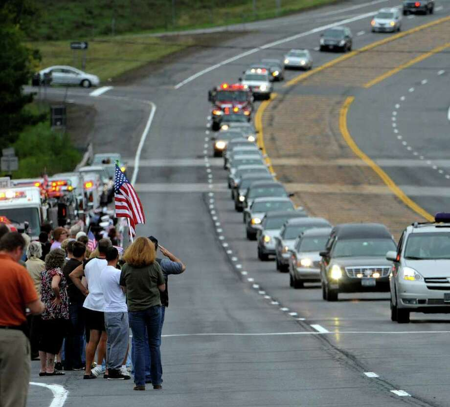 The casket carrying the remains of Staff Sgt. Derek Farley is moved down Routes 9 and 20 in Schodack on August 25, 2010.   (Skip Dickstein/Times Union) Photo: Skip Dickstein