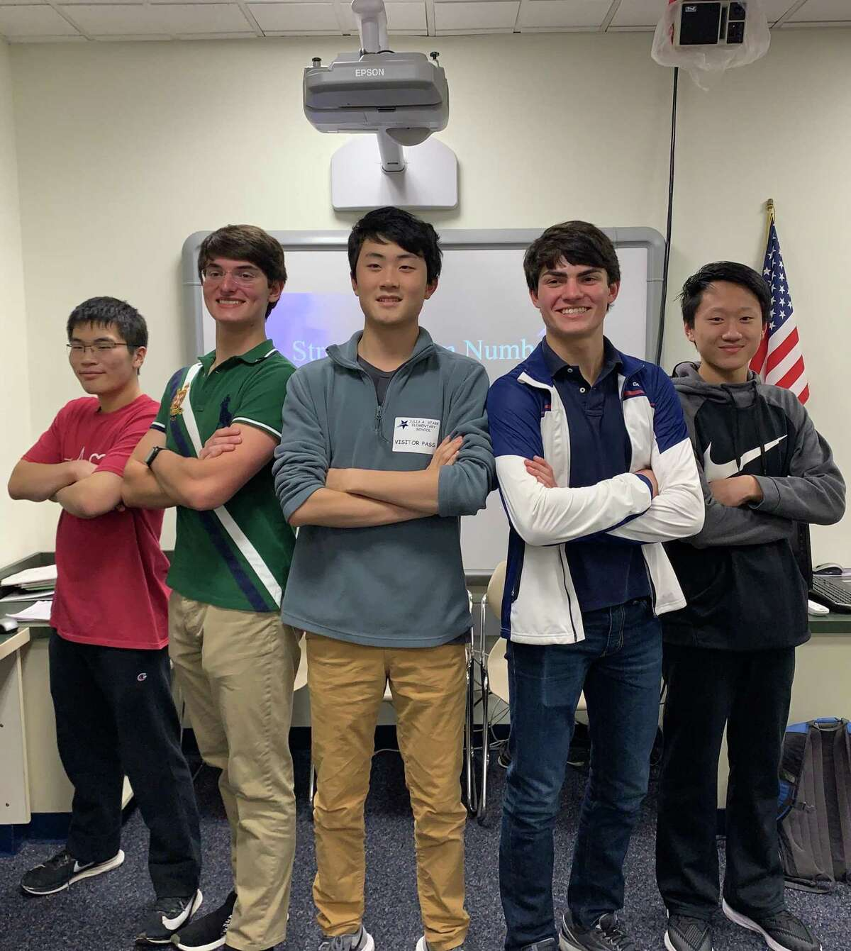 Marcus Feng, left, Jonathan Strong, Ming Wu, James Strong, Andrew Qin. Not pictured, Luke Smith. Darien High School seniors James Strong (president and co-founder) and Ming Wu (co-founder) have worked to bring fourth and fifth graders a program that pushes their minds while exciting them about the field of mathematics.