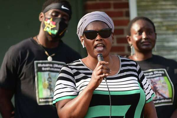 Omo Klusum Mohammed, mother of Mubarak Soulemane, who was slain by a state trooper, speaks as over 200 people gathered at Veterans Memorial Park Friday, June 19, 2020, to celebrate Juneteenth and protest police brutality in Norwalk, Conn.