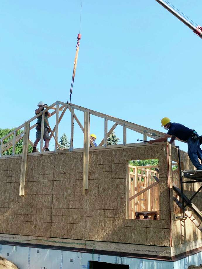 A Habitat for Humanity house begins to take shape in Eastlake on Saturday. (Dylan Savela/News Advocate)