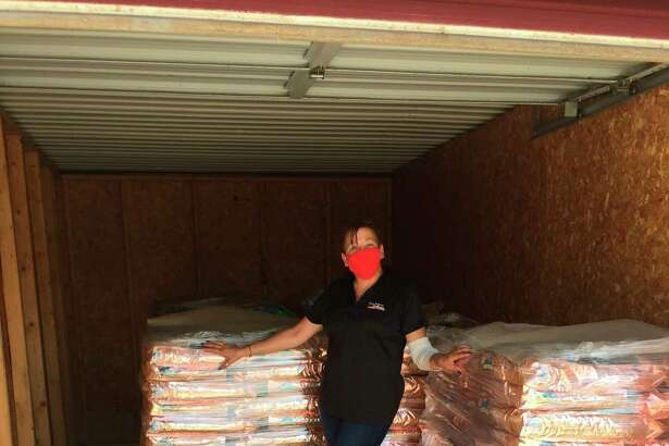 Dow employee Rosebud Peters was in charge of transporting1,000 bags of dog food that Dow donated to the Humane Society of Midland County fromMBS International Airportto Midland. (Photo provided by Jesse Donahue)
