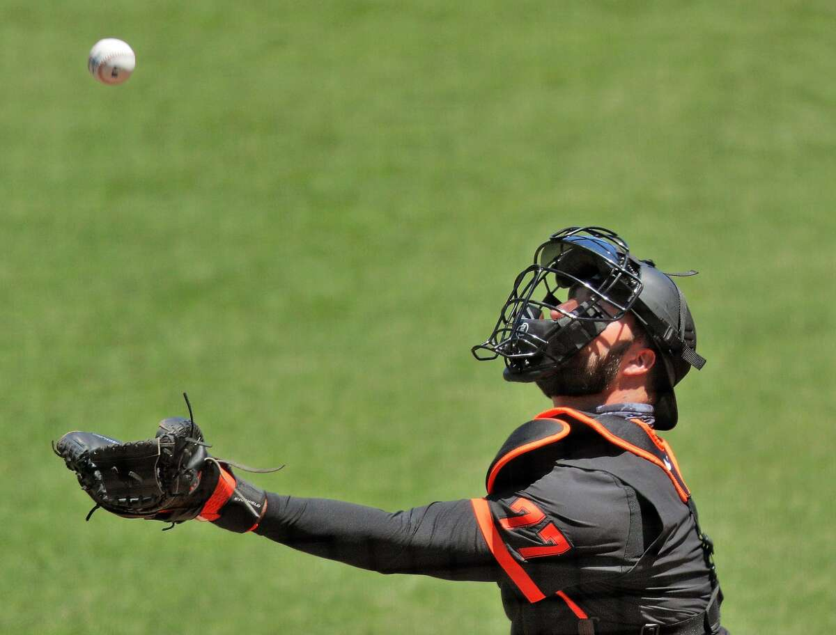 Giants catcher Joey Bart fields a pop up as the San Francisco Giants worked out and played a simulated game at Oracle Park in San Francisco, Calif., on Wednesday, July 8, 2020.