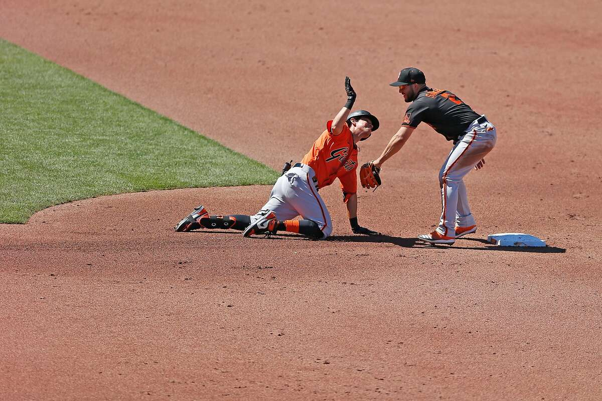 San Francisco Giants Yolmer S‡nchez tags Giants Mauricio Dubon as Dubon playfully bats down S‡nchez�s glove at second base during Spring Training at Oracle Park on Saturday, July 11, 2020, in San Francisco, Calif.