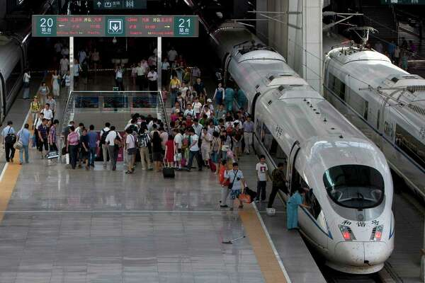 In this photo taken on Tuesday, July 26, 2011, passengers disembark a CRH high-speed train at the South Train Station in Beijing, China.