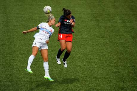 HERRIMAN, UT - JULY 12: Rachel Daly #3 of Houston Dash attempts a header with Paige Nielsen #14 of Washington Spirit during day 7 of the NWSL Challenge Cup at Zions Bank Stadium on July 12, 2020 in Herriman, Utah.