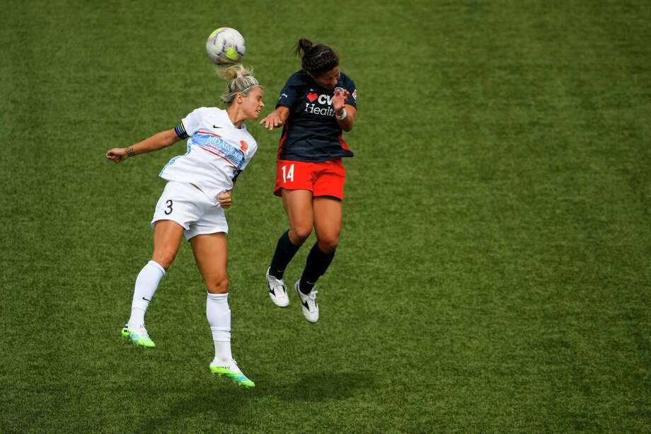 HERRIMAN, UT - JULY 12: Rachel Daly #3 of Houston Dash attempts a header with Paige Nielsen #14 of Washington Spirit during day 7 of the NWSL Challenge Cup at Zions Bank Stadium on July 12, 2020 in Herriman, Utah. Photo: Alex Goodlett, Getty Images / 2020 Getty Images