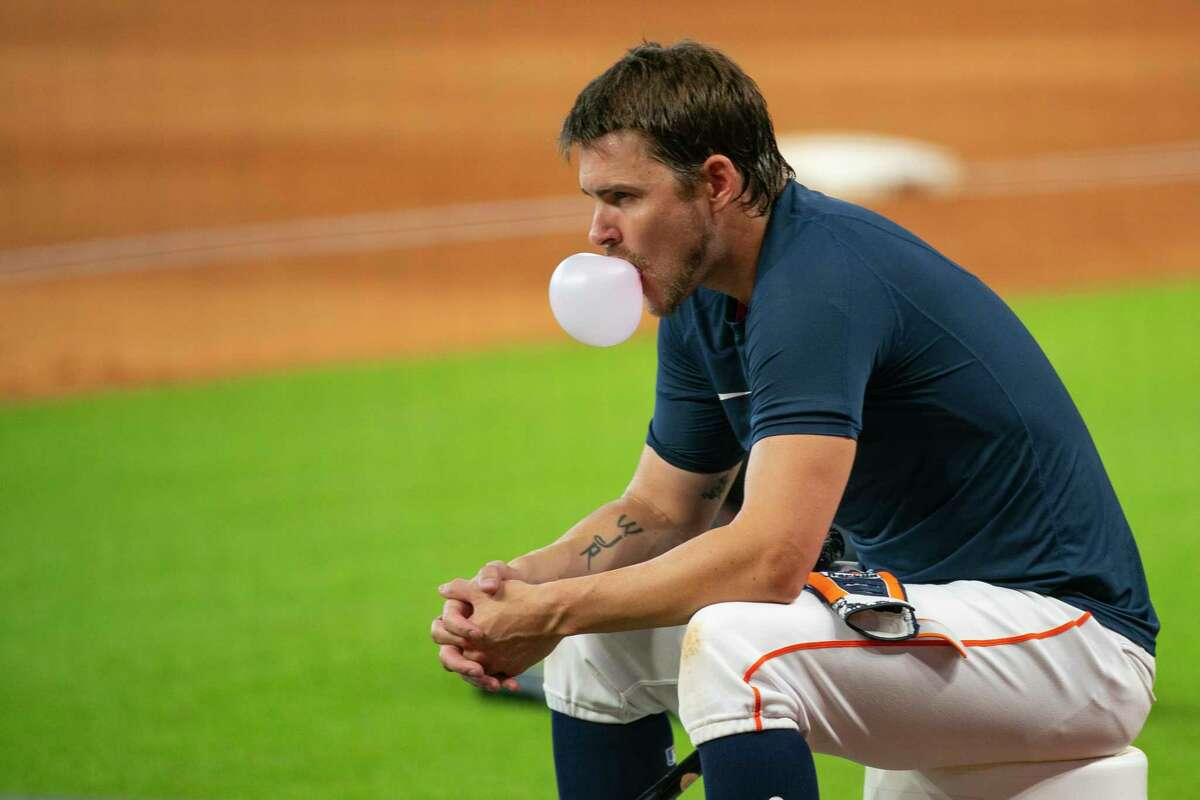 Houston Astros right fielder Josh Reddick (22) watches batting practice during Astros summer training camp workout, Sunday, July 12, 2020, at Minute Maid Park in Houston.