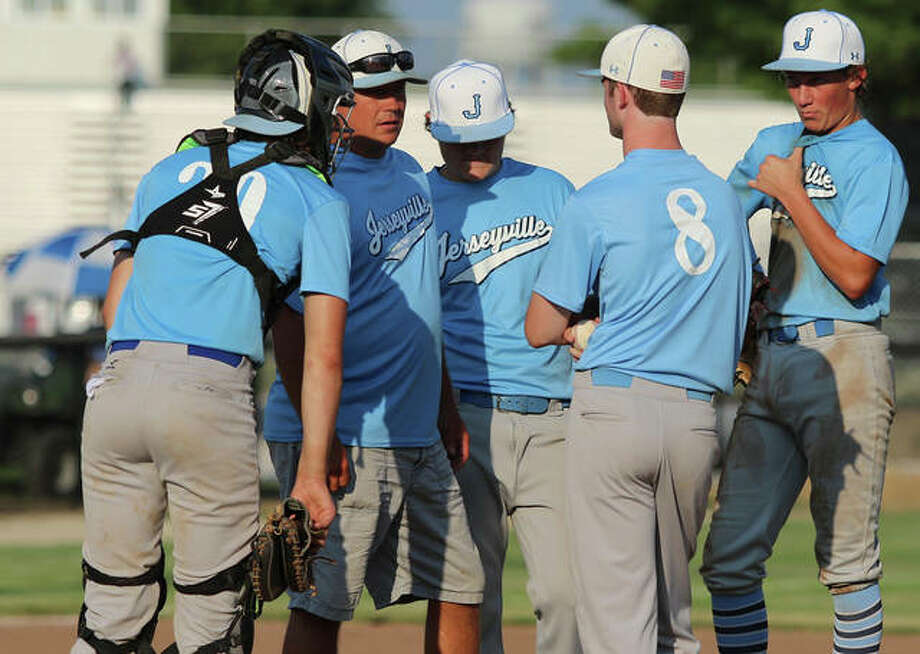 Jersey coach Darren Perdun (second left) talks with pitcher Nevan McDuffie (8) while teammates listen in during a mound visit in a game Wednesday at Ken Schell Field in Jerseyville. Photo: Greg Shashack / The Telegraph