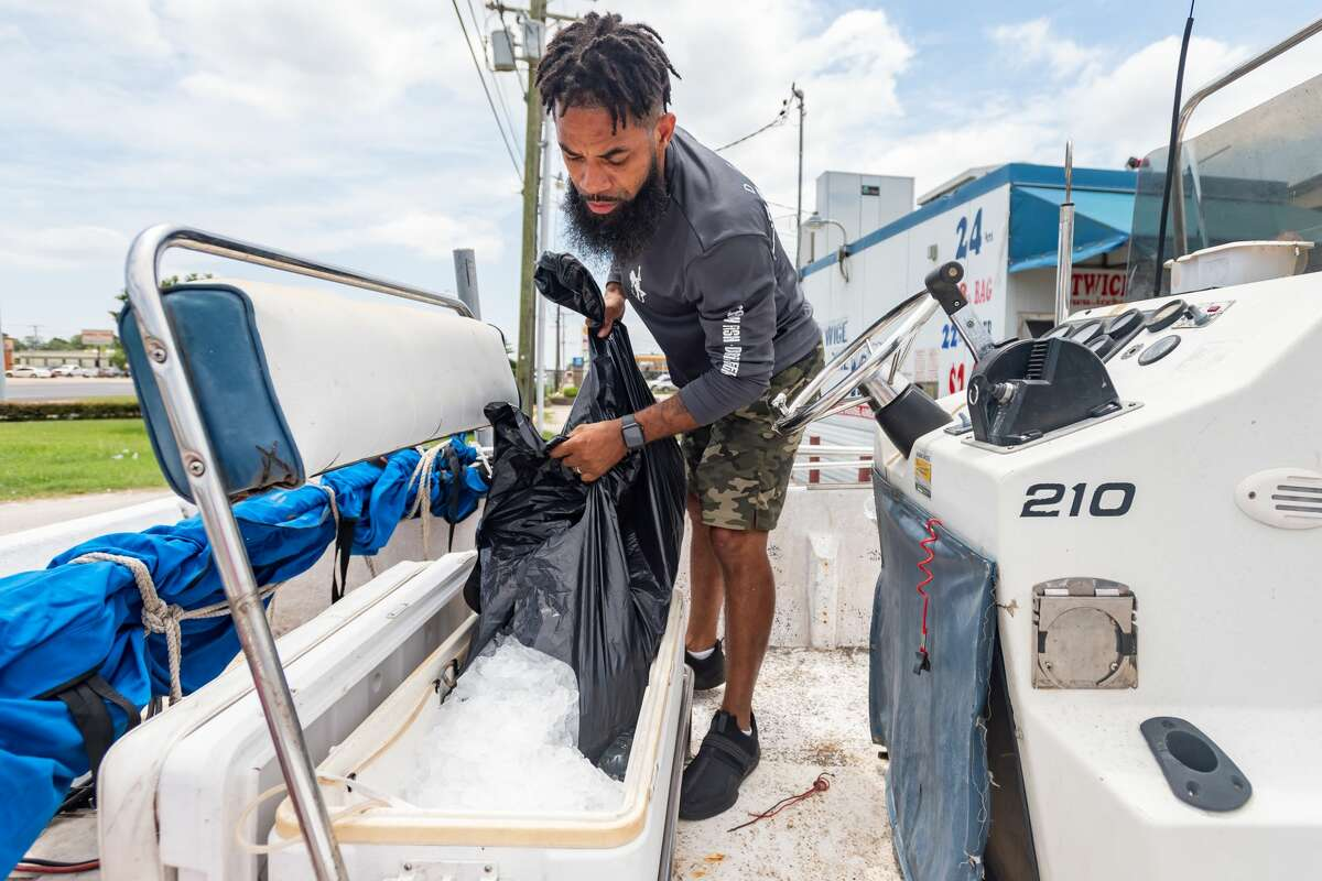 At one of the busiest places in Port Arthur, John Sampy fills the cooler in his boat with bulk ice cubes from the Twice The Ice machine at 26th and Memorial Boulevard on Sunday. Photo made on July 12, 2020. Fran Ruchalski/The Enterprise