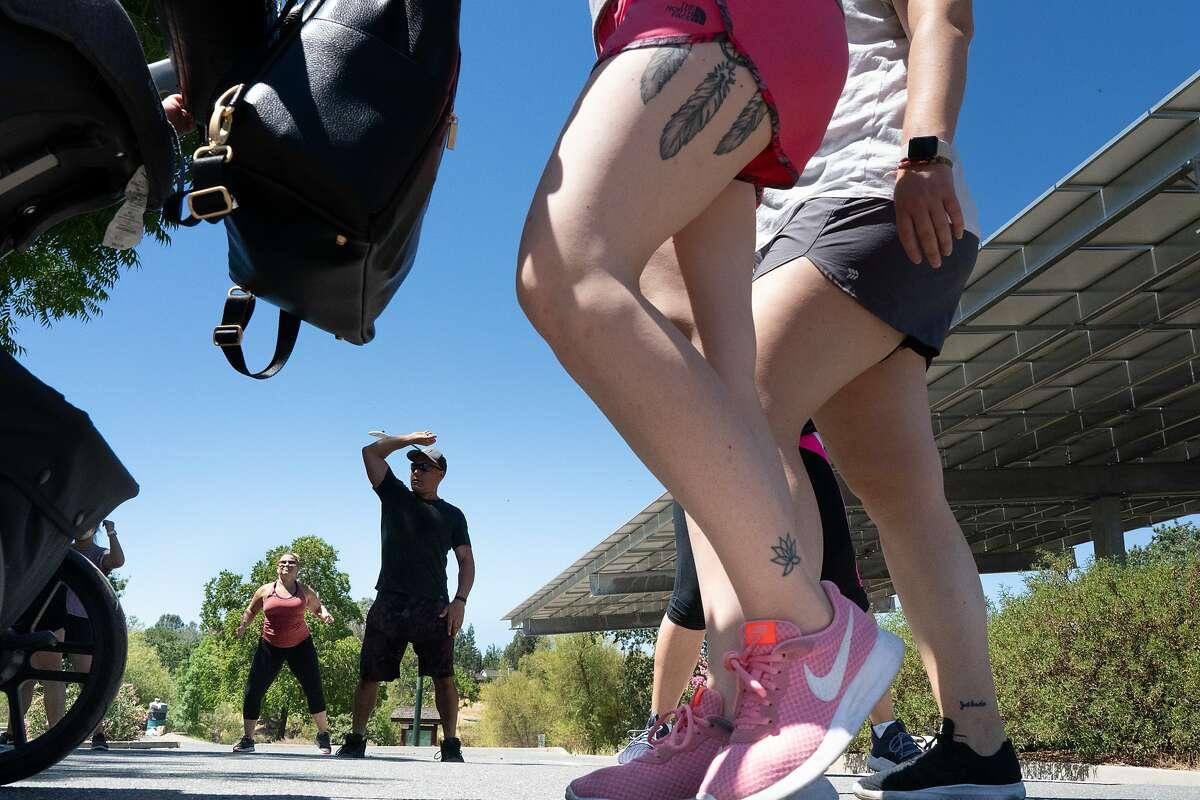 People enjoying U-Jam at Heather Farm Park as temperatures reach 100 degrees Fahrenheit on Sunday, July 12, 2020 in Walnut Creek, Calif.