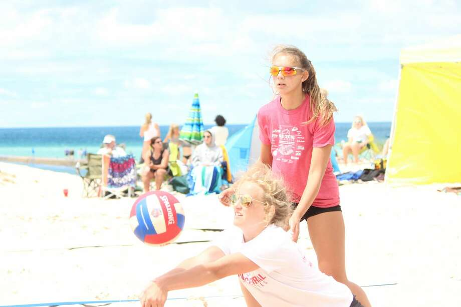 Youth volleyball players from across the region compete in a beach volleyball tournament, sponsored by North Shore Volleyball, at Frankfort Beach on July 12. Photo: Robert Myers