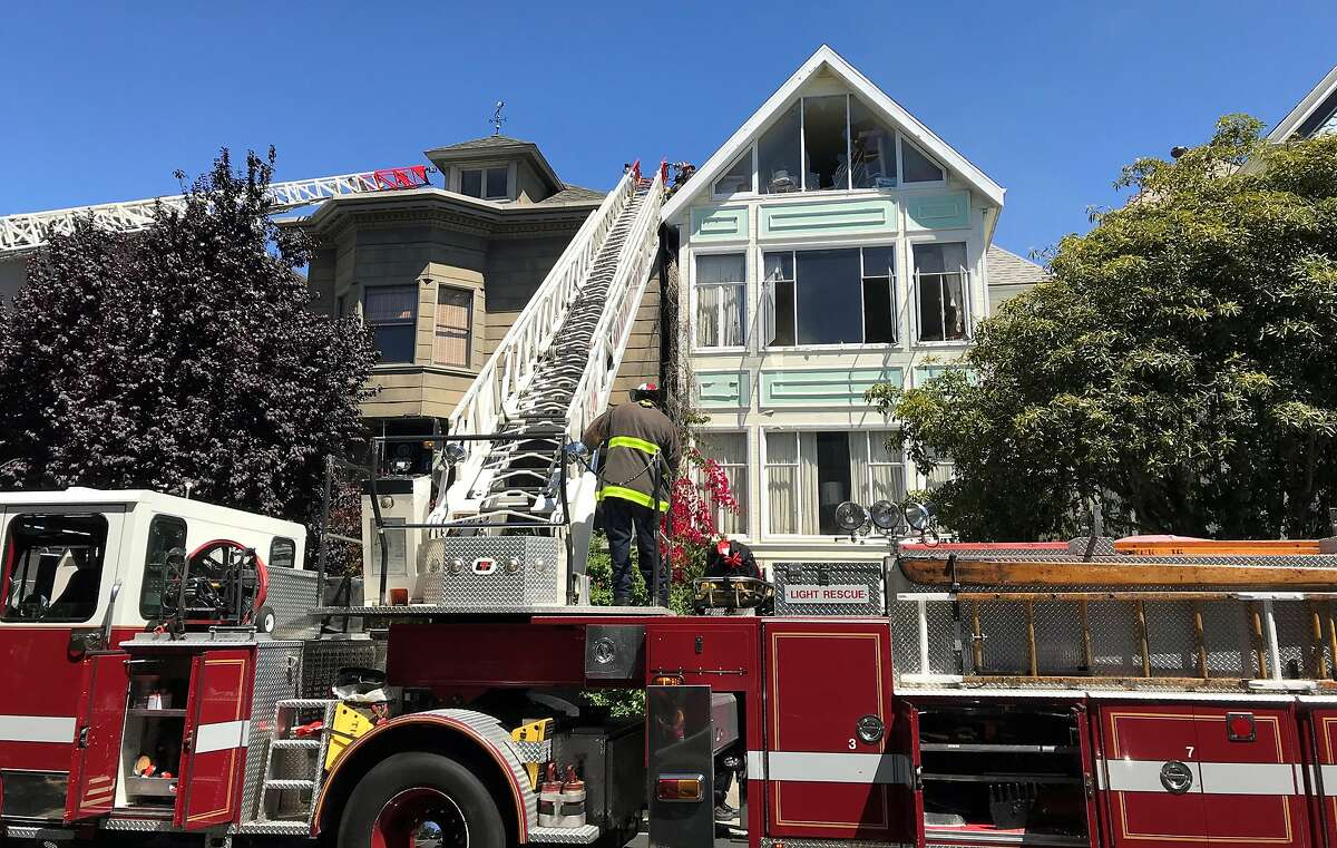 At least two ladder trucks were dispatched to a fatal house fire on Sunday morning on Sacramento Street in the Presidio Heights section of San Francisco.