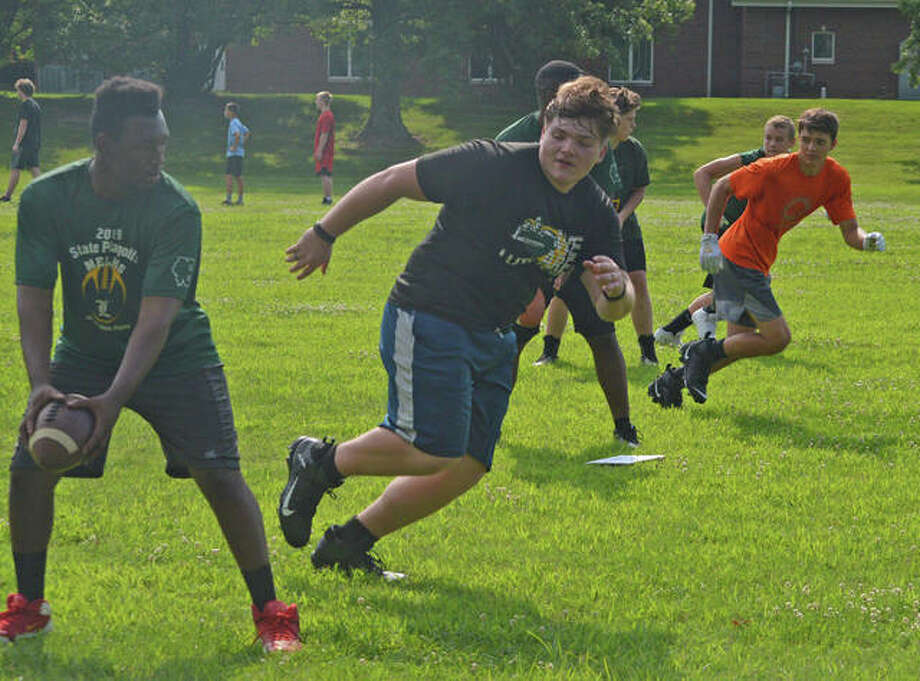 The Metro-East Lutheran football team practices on Wednesday afternoon. Under the revised guidelines issued Thursday by the IHSA for its Return to Play plan, athletes will have to wear a mask. Photo: Intelligencer Sports Staff