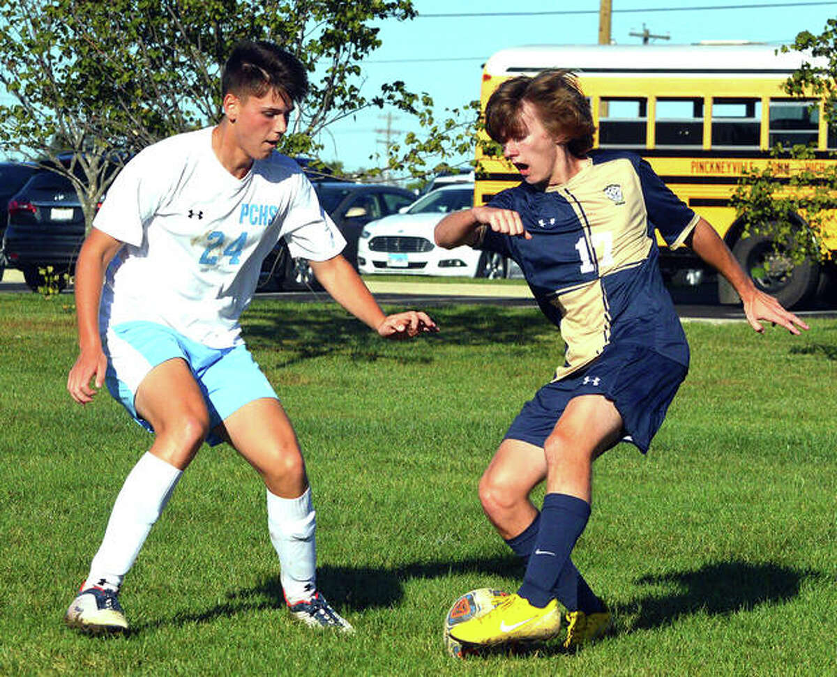 Father McGivney's Kellen Weir, right, tries to get past a Pinckneyville defender during the first half of a game last season. Boys soccer is one of the sports affected by the latest adjustments to the IHSA's Return to Play plan, including no contact drills or physical contact.