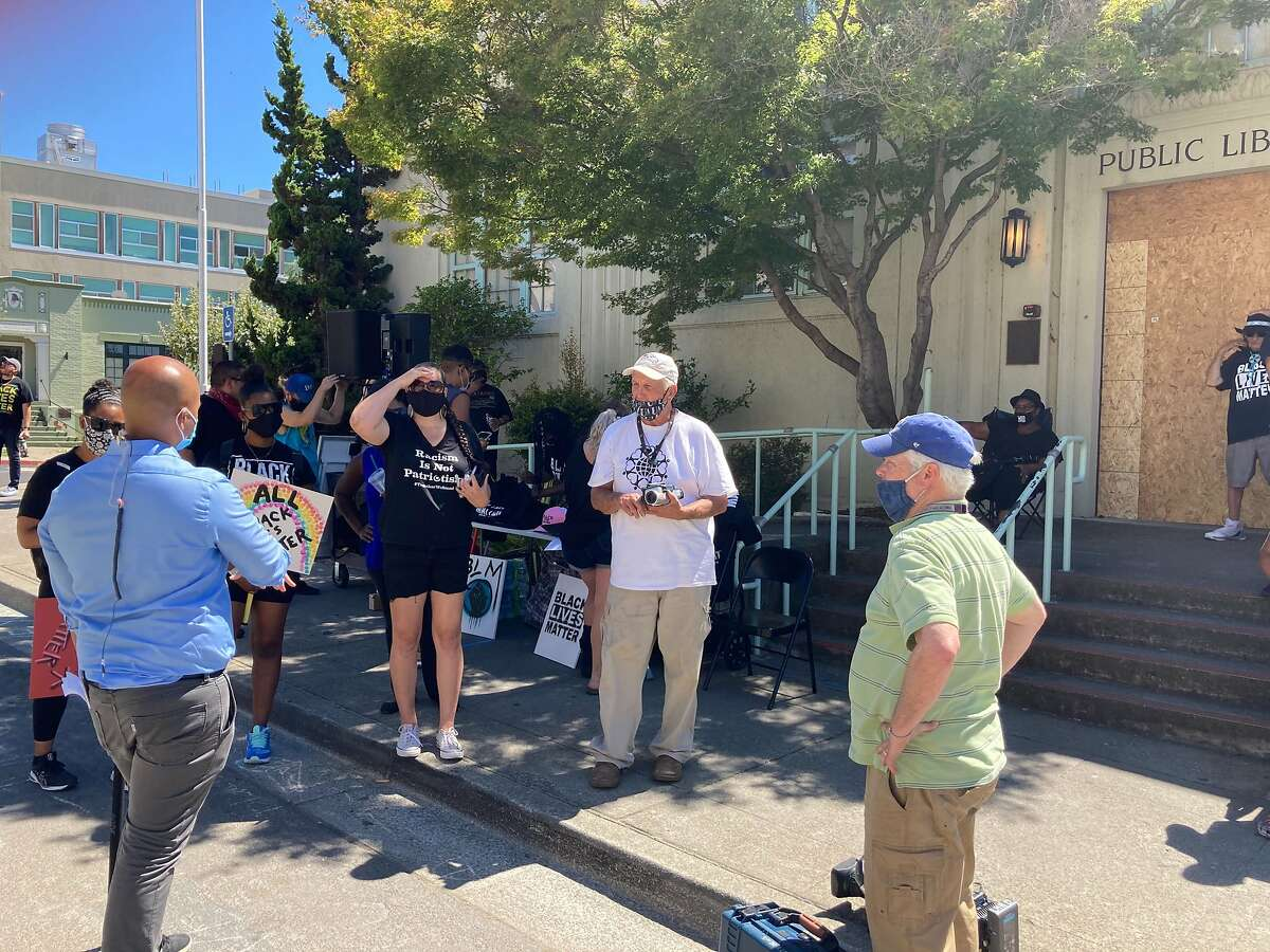 People began gathering in Martinez ahead of an afternoon Black Lives Matter protest in Martinez, Calif., on Sunday, July 12, 2020. Businesses were boarded up.