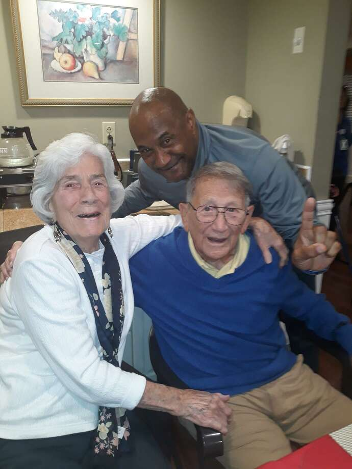 John DeNunzio, right, is pictured with his wife, Catherine, and Lorenzo Marshall Sr. just before Christmas 2019. Marshall played football and baseball for DeNunzio at Middletown High in the 1970s. Photo: Contributed Photo
