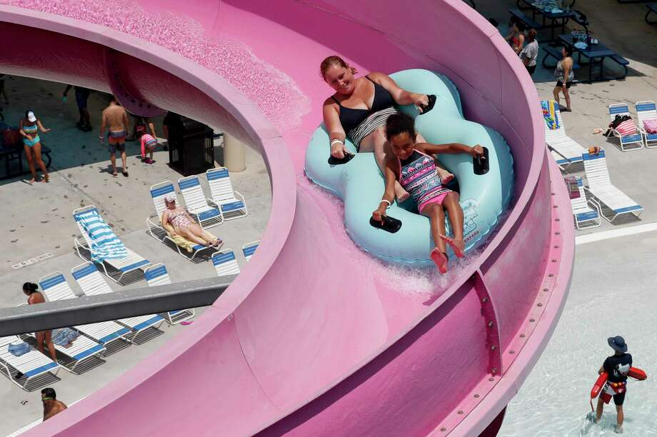 People seek refuge from the severe heat at Typhoon Texas Waterpark on Sunday, July 12, 2020, in Katy, Texas. The waterpark is operating at 25 percent occupancy because of the COVID-19 pandemic. Photo: Godofredo A. Vásquez, Houston Chronicle / Staff Photographer / © 2020 Houston Chronicle
