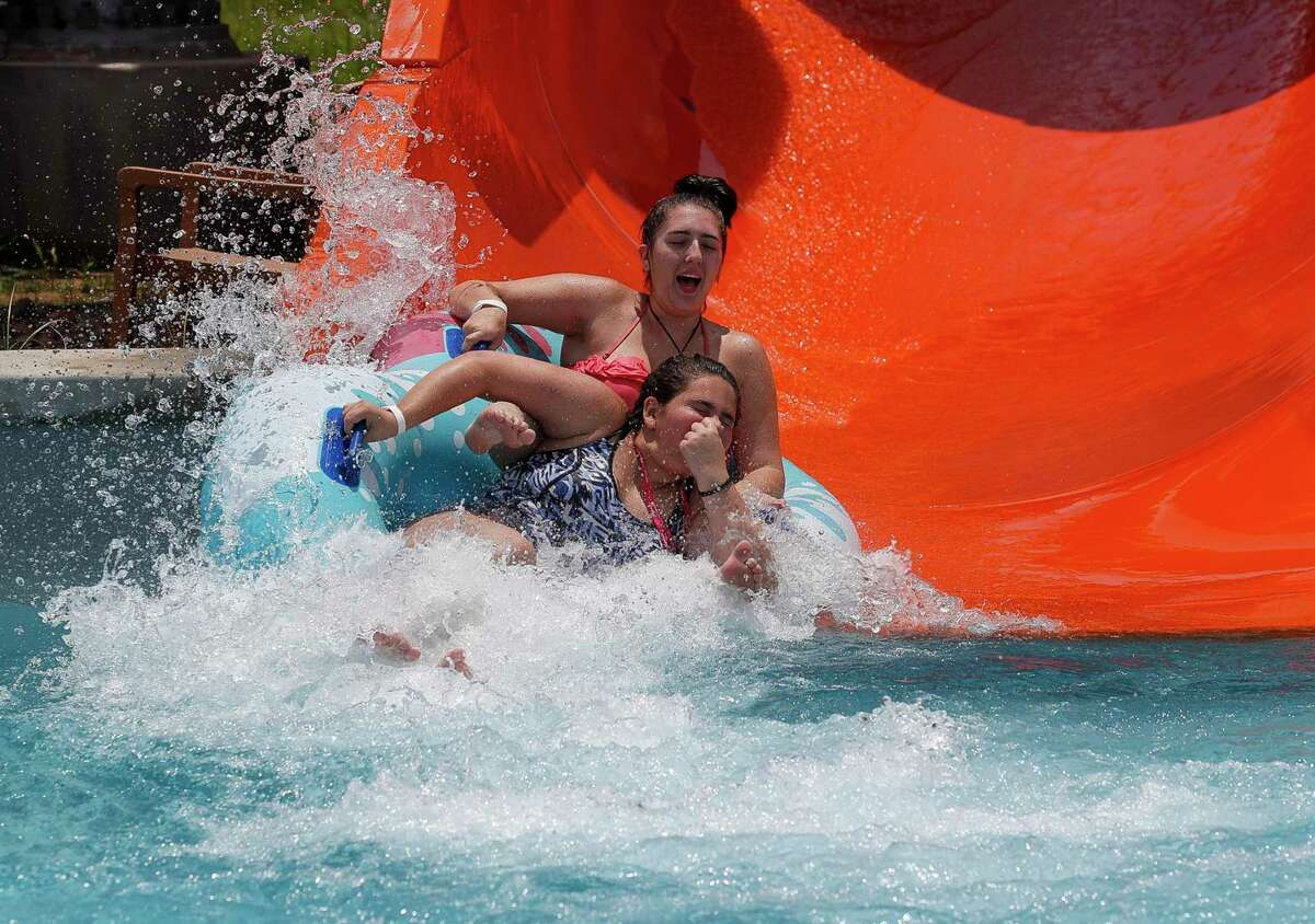 People seek refuge from the severe heat at Typhoon Texas Waterpark on Sunday, July 12, 2020, in Katy, Texas.