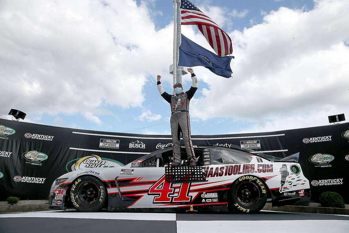 SPARTA, KENTUCKY - JULY 12: Cole Custer, driver of the #41 HaasTooling.com Ford, celebrates in Victory Lane after winning the NASCAR Cup Series Quaker State 400 Presented by Walmart at Kentucky Speedway on July 12, 2020 in Sparta, Kentucky. (Photo by Jared C. Tilton/Getty Images)
