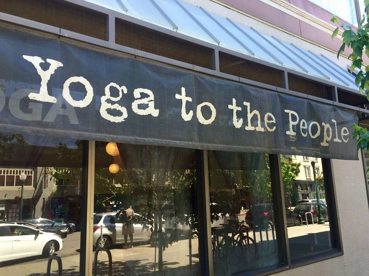 FILE - The exterior of Yoga to the People is seen in Berkeley. The popular yoga studio chain with additional locations in San Francisco and Oakland, as well as New York City and Tempe, Ariz. will close amid allegations of sexual assault and racial discrimination.