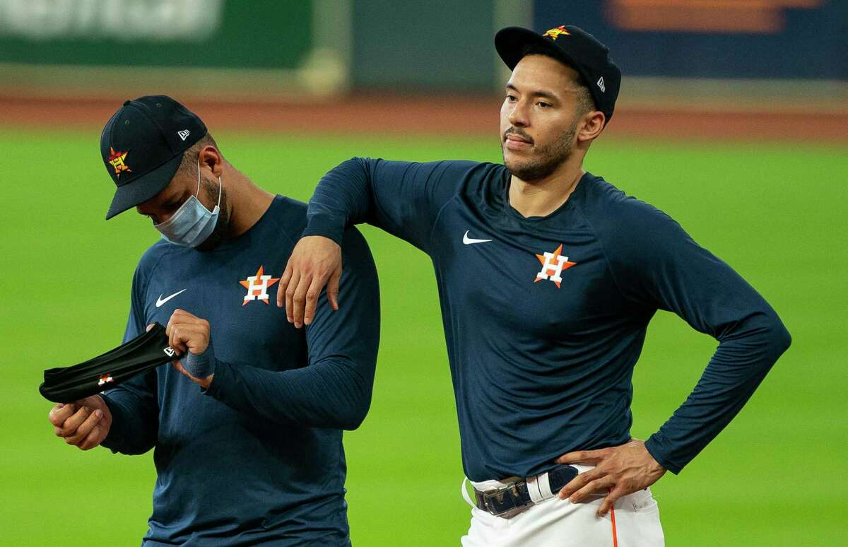 Astros first baseman Yuli Gurriel, left, and shortstop Carlos Correa fell short to a pair of Mariners in the defensive metrics used to determine this year's Gold Glove winners.