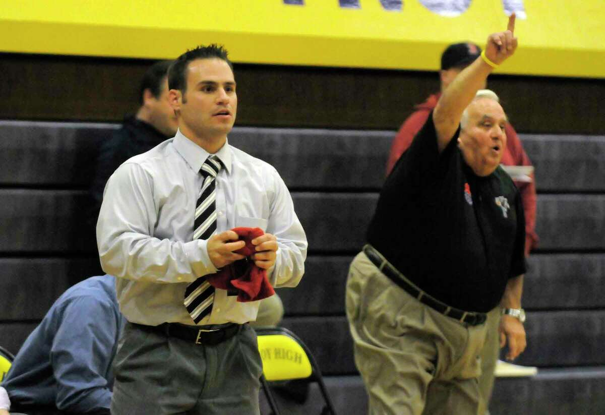 Schenectady head coach Eric Loudis,left, and his father assistant coach jim Loudis direct their team during their high school boys basketball game against troy High School in Troy 12/17/2010.( Michael P. Farrell/Times Union )