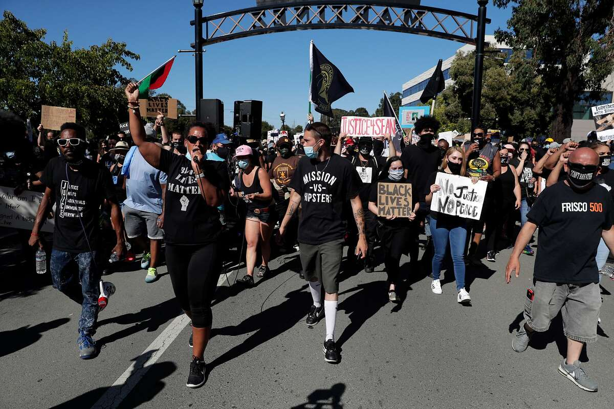 Leia Schenk leads the group of demostrators on Marina Vista Ave. during a Black Lives Matter protest put together by Together We Stand Revolution following several days of back and forth between supporters and opponents to a BLM mural painted in Martinez, Calif., on Sunday, July 12, 2020. Other groups involved were Southern Alameda County Resistance as well as with the local group, Martizians for Black Lives.