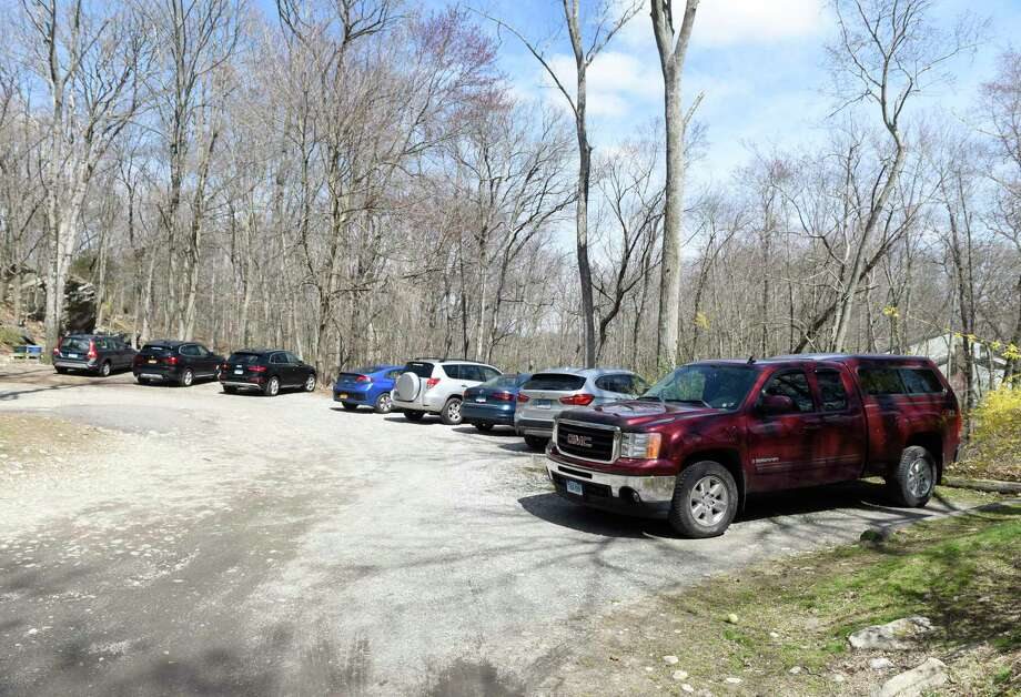 Cars are parked at the entrance of the Greenwich-owned section of Mianus River Park on Wednesday, April 1, 2020. Photo: File / Tyler Sizemore / Hearst Connecticut Media / Greenwich Time