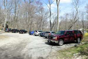 Cars are parked at the entrance of the Greenwich-owned section of Mianus River Park on Wednesday, April 1, 2020.