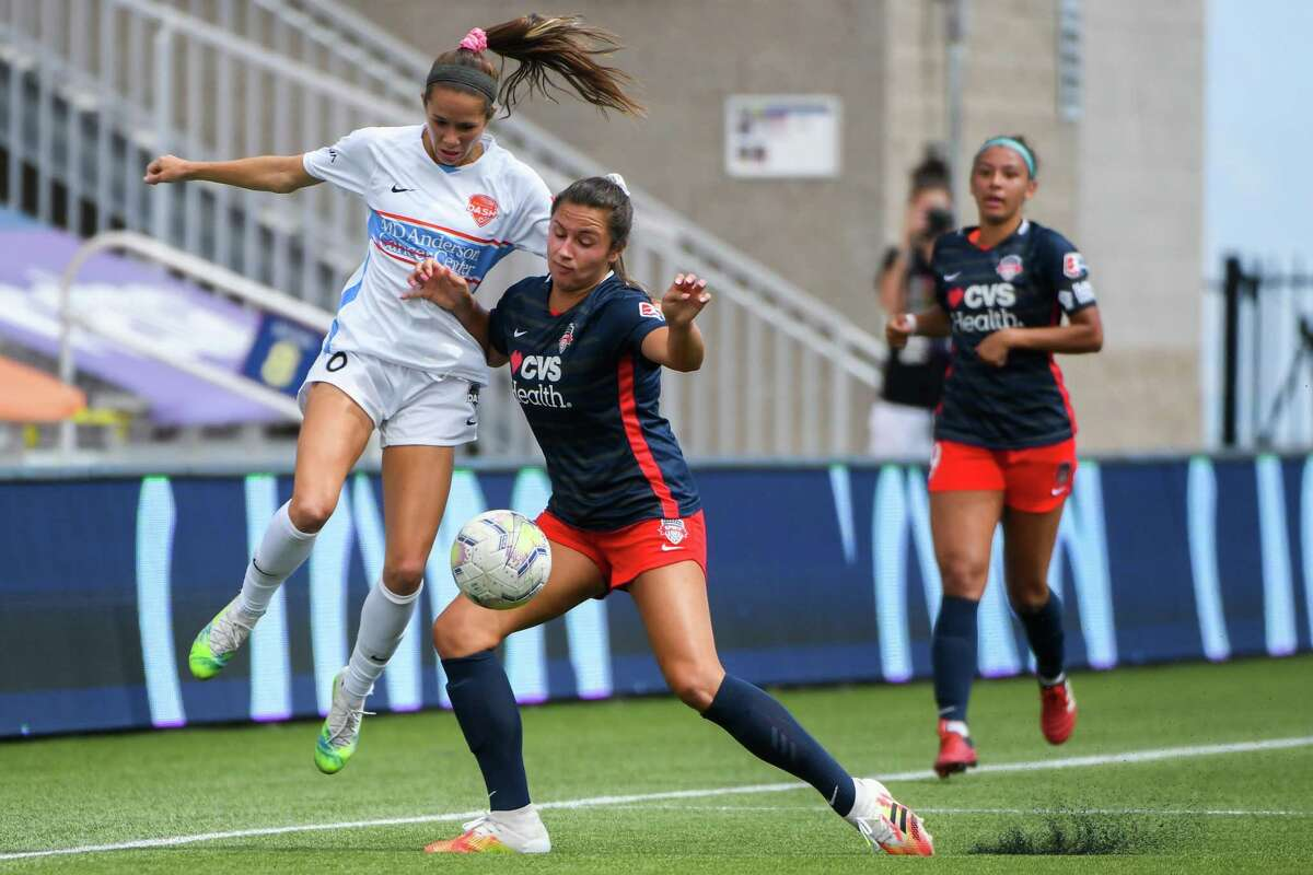 The Dash's Shea Groom, left, battles the Spirit's Sam Staab for control of the ball in Sunday's NWSL Challenge Cup match at Herriman, Utah.