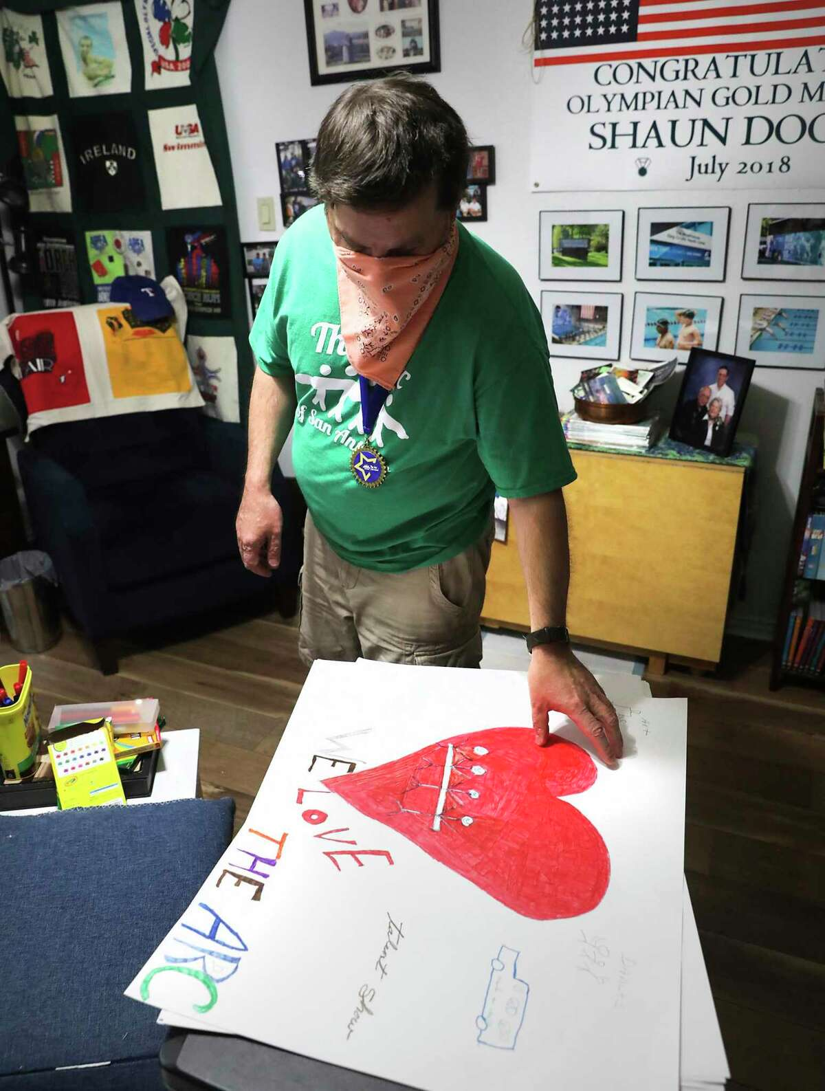 Shaun Dooley, a participant in the ARC's Adult Life Enrichment program, has found great satisfaction and meaningful relationships at the ARC, on Friday, May 22, 2020. He is making a poster to give to friends at the ARC.