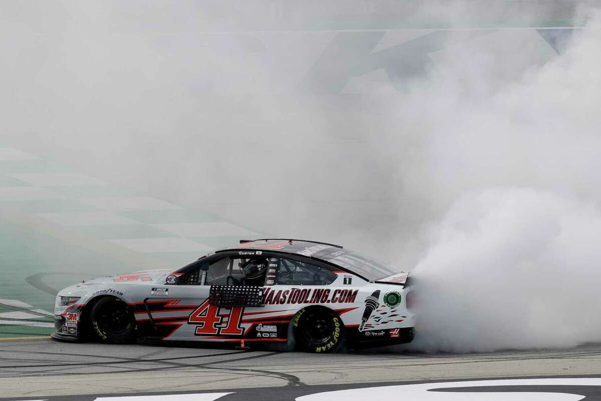 Cole Custer (41) celebrates after winning a NASCAR Cup Series auto race Sunday, July 12, 2020, in Sparta, Ky. (AP Photo/Mark Humphrey)