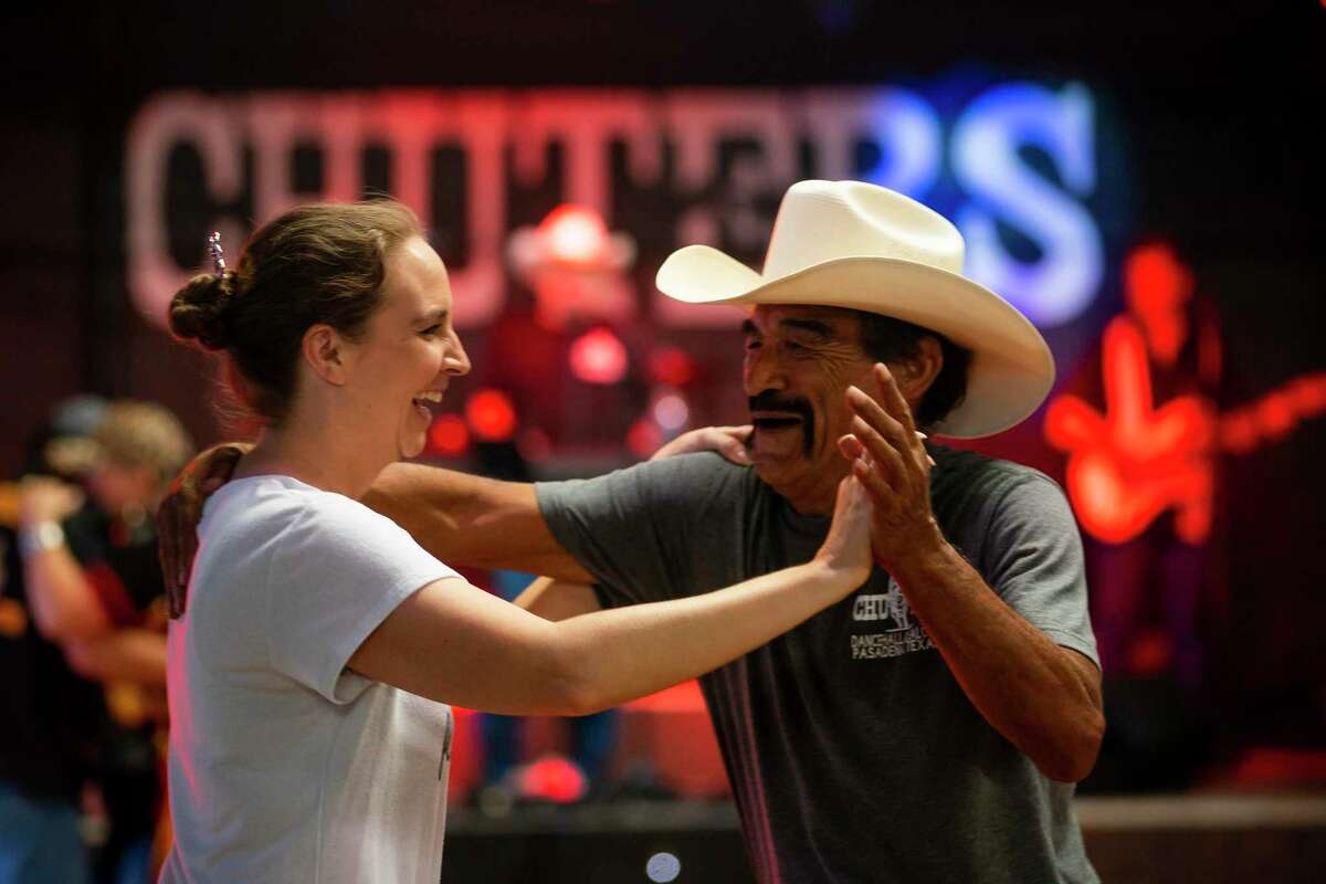 Kristina Reff dances with Pete Hinojosa to the band Chris Bergeron and County Line on the dance floor Sunday, July 12, 2020, at Chuters Dance Hall and Saloon in Pasadena. The bar opened in spite of Governor Greg Abbott's order that all bars should be shutdown, holding a rally and protest on Sunday afternoon.
