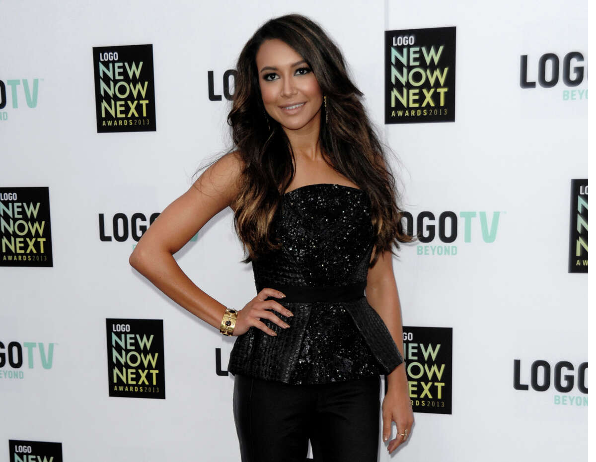 FILE - In this April 1,3 2013, file photo, actress Naya Rivera arrives at Logo's NewNowNext Awards in Los Angeles. A member of a team searching a Southern California lake for Rivera, the missing TV star, said Sunday, July 12, that he's confident his crew is getting a clearer idea of where in the lake to find her, a magazine reported. Robert Inglis of the Ventura County Sheriff's Office Search & Rescue Team told Us Weekly that Rivera sent to a family member of picture of her 4-year-old son, Joey, in front of a cove before she disappeared July 8 after diving into Lake Piru. (Photo by Dan Steinberg/Invision/AP, File)