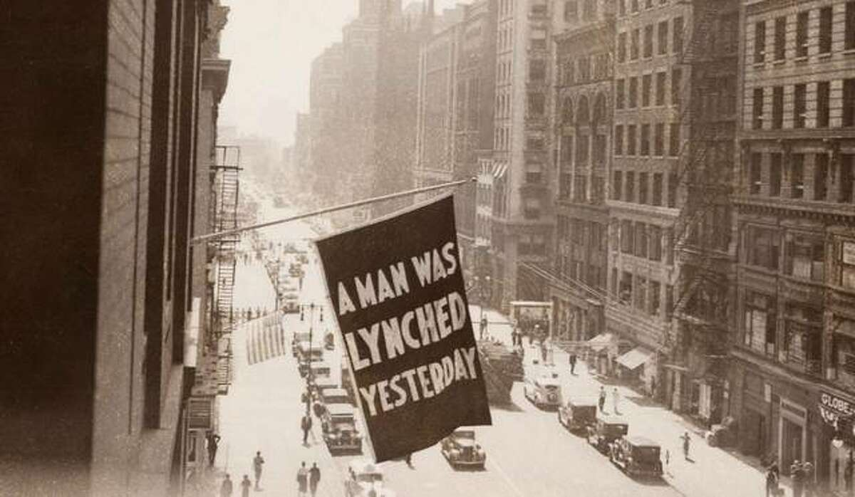 A flag at the NAACP headquarters in New York announces that a man was lynched.