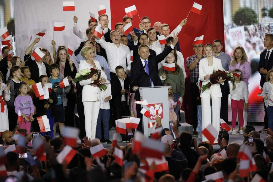 Andrzej Duda (center) gestures while speaking during an election night rally as exit polls are announced near Pultusk Castle in Pultusk, Poland, on July 12, 2020. Photo: Bloomberg Photo By Piotr Malecki. / © 2020 Bloomberg Finance LP