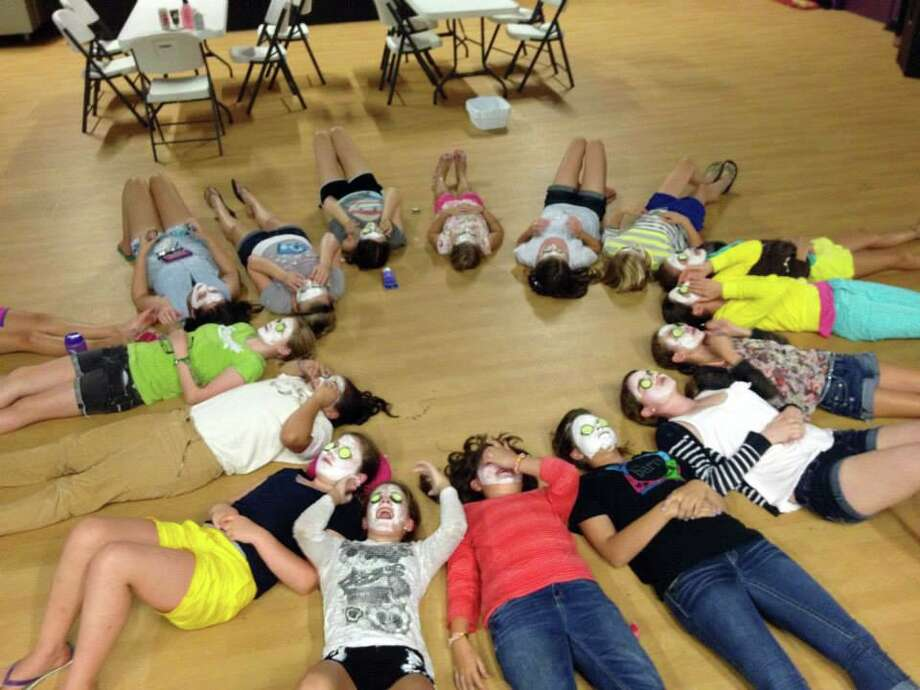 Campers enjoy a day of relaxation during one of the summer camps offered through The Barn. The nonprofit organization in Madison has started summer camps for this summer, following strict COVID-19 protocols to keep all attendees safe. Photo: Contributed /