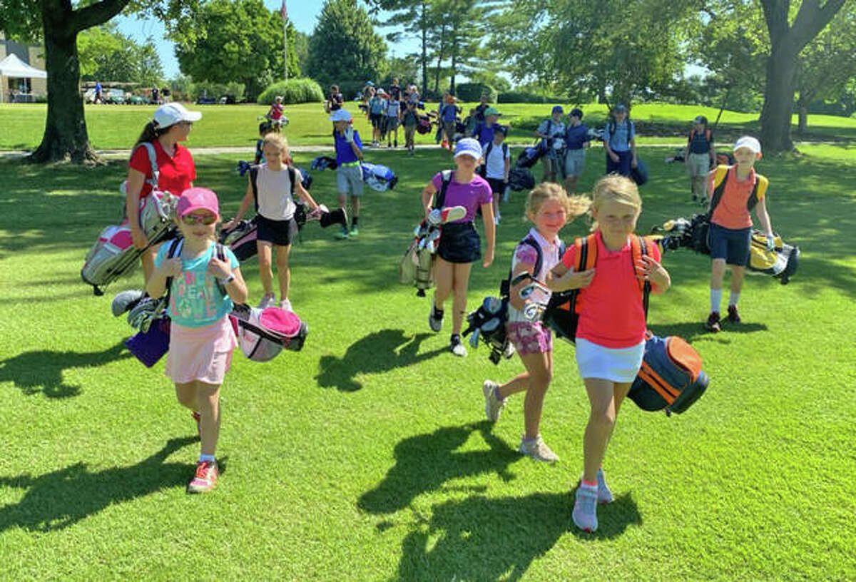 Junior golfers at Sunset Hills Country Club prepare for an instruction session on Wednesday morning.